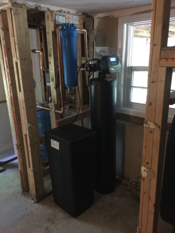 softener sediment filtration installed in basement at point of entry