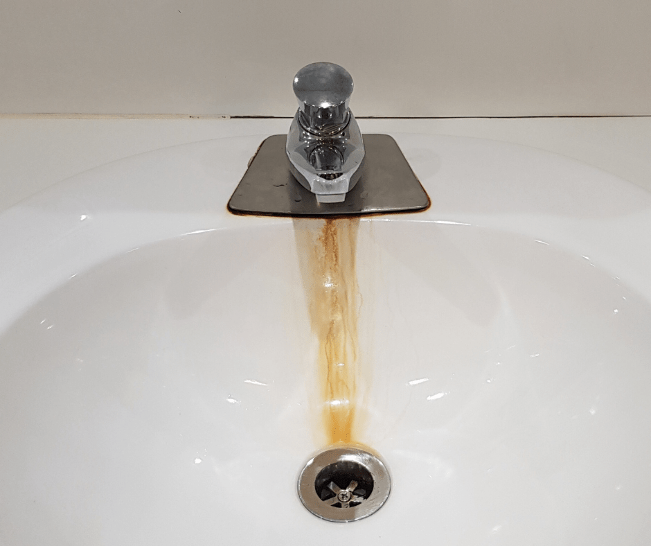 sink and faucet with rust stains from iron oxidation